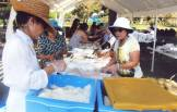 Volunteers prepping bento boxes at the Picnic! Photographed by Eric Takushi.