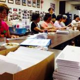 Volunteers prepping one of our quarterly newsletters! Photographed by Joseph Kamiya.