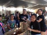 Volunteers at the Bazaar's saataa andaagii booth! Photographed by Eric Takushi.